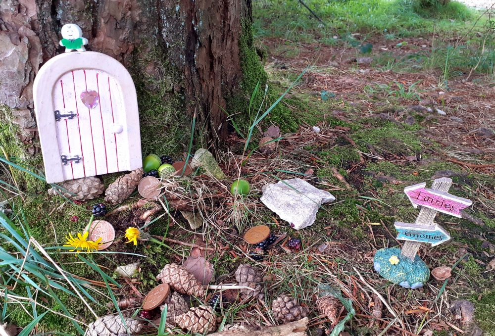 Children leave pine cones to buy wishes at the Faery Steps