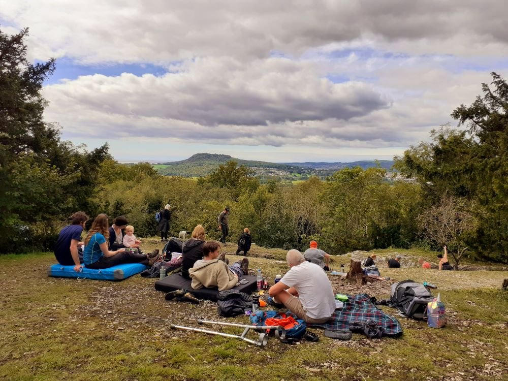 Picnickers at the top of the Faery Steps enjoy the view of Arnside Knott