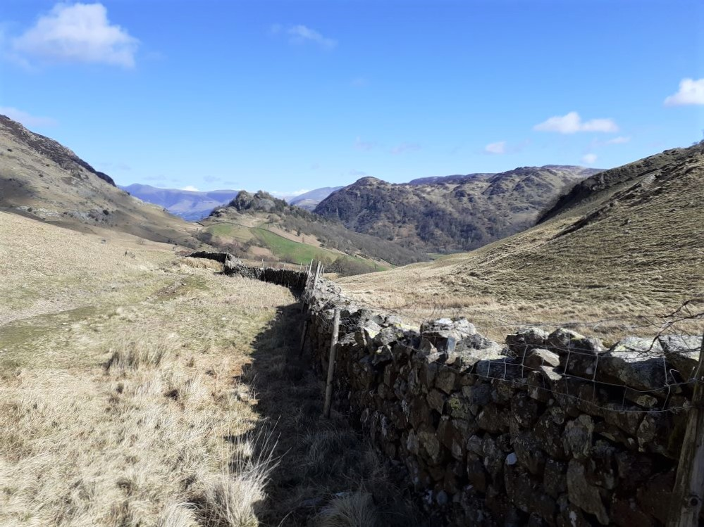 Drystone wall with Castle Crag in the distance