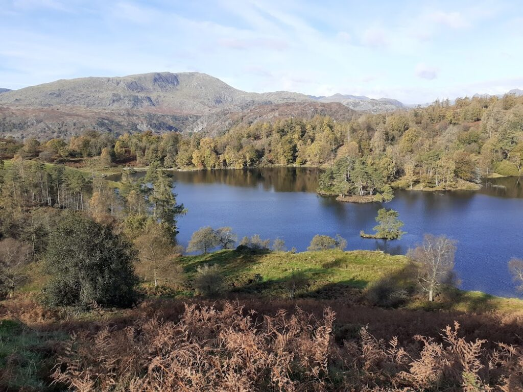 Tarn Hows in Autumn with reflections on the water