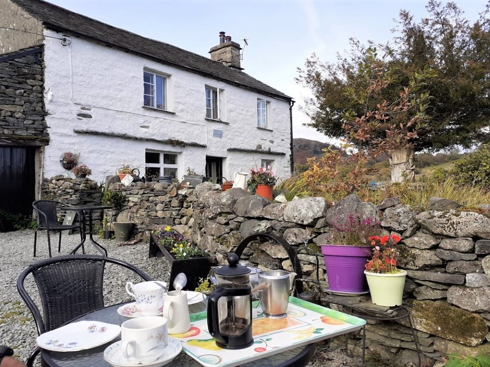 Whitewash walled cottage with tea tray in the foreground